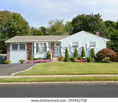 Beautiful Landscaped Suburban Ranch Style Home Residential Neighborhood USA - stock photo