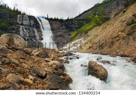 beautiful landscapes with picturesque waterfall and rapid mountain river in Banff National Park, Alberta, Canada - stock photo