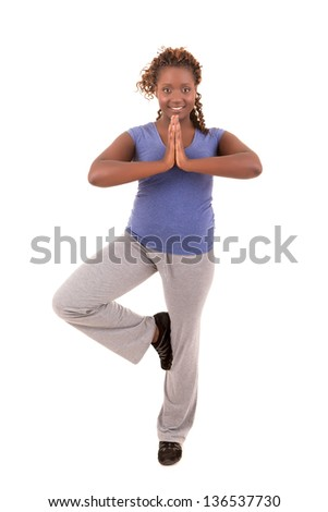 Beautiful large african woman doing exercise - Isolated over white - stock photo