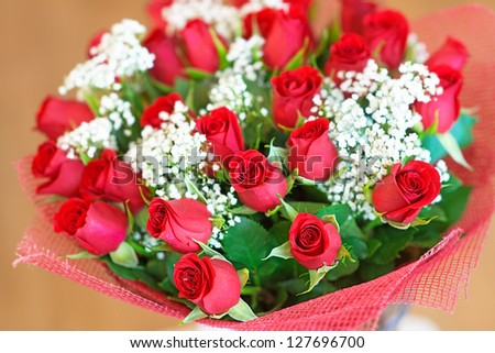 Beautiful large festive bouquet of red roses. - stock photo