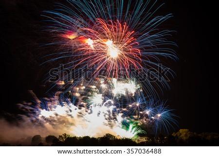 Beautiful large fireworks display against night sky - stock photo