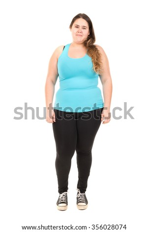 Beautiful large girl in fitness outfit isolated in white - stock photo