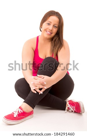 Beautiful large woman exercising - isolated over a white background
