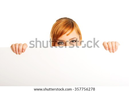 Beautiful large woman holding a white board