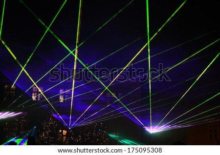 beautiful laser show with green glow in the night
