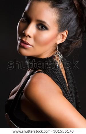 Beautiful latin american woman on black - stock photo