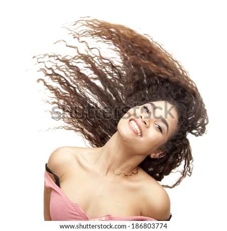Beautiful latin girl moving her hair over white background - stock photo