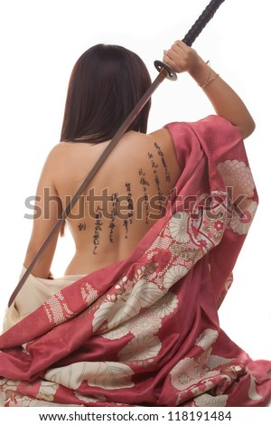 Beautiful latin girl with japanese disguise and tattoo isolated in white background - stock photo