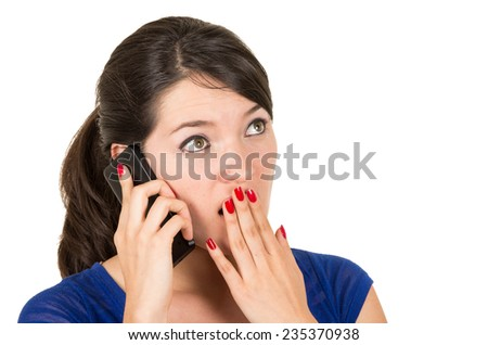 beautiful latin surprised young girl talking on her cell phone covering her mouth with hand isolated on white - stock photo