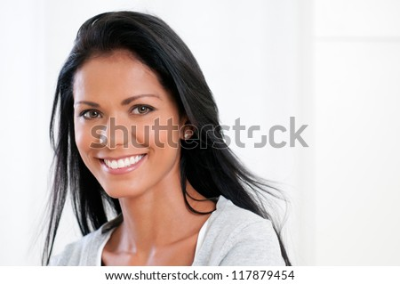 Beautiful latin woman smiling and looking at camera isolated on white background - stock photo