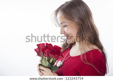 Beautiful latin woman with a bouquet of red roses - stock photo