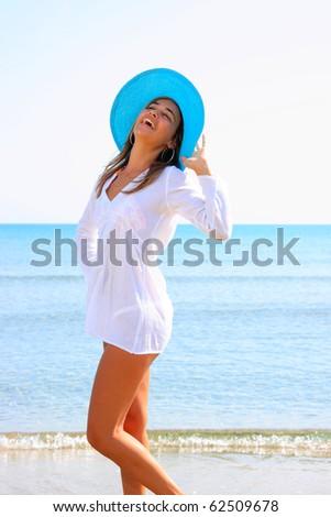 Beautiful latino woman by the sea in Greece - stock photo