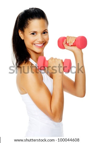 Beautiful latino woman do toning exercises with dumbbells in studio - stock photo