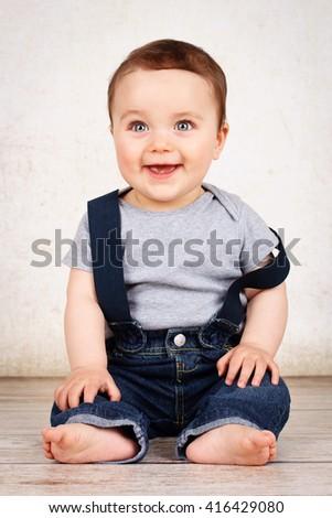 Beautiful laughing baby - stock photo