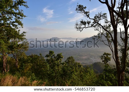 Beautiful layers of mountain range landscape with winter blue sky from top view in majestic sunrise and fog