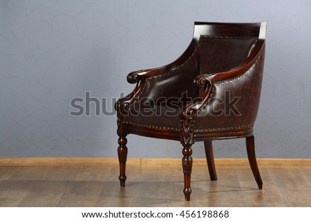 Beautiful Leather Armchair In Retro Style Studio Is On Wooden Floor