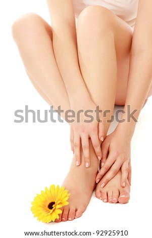 Beautiful legs and feet with flower, isolated on white background