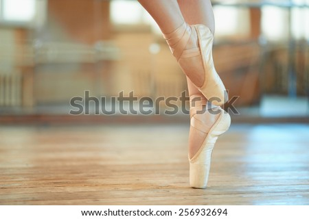 beautiful legs of a dancer in pointe - stock photo