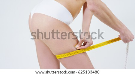 Beautiful legs of a young girl without cellulite, clean tender skin, good care, sports figure, on a white background. Concept: anti cellulite, proper nutrition,spa procedures,healthy lifestyle,jogging
