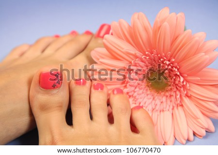 Beautiful legs with perfect spa pedicure - stock photo