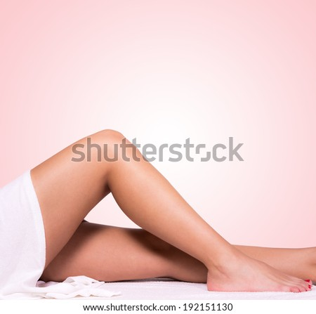 Beautiful legs with pink background - stock photo