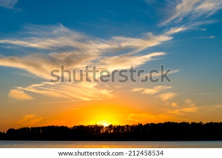 beautiful light clouds in the night sky - stock photo