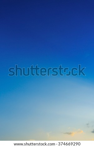 beautiful light on clear blue sky, light beam of sunlight through clouds above sunset sky - stock photo