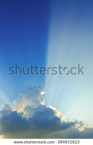 beautiful light on clear blue sky, light beam of sunlight through clouds above sunset sky