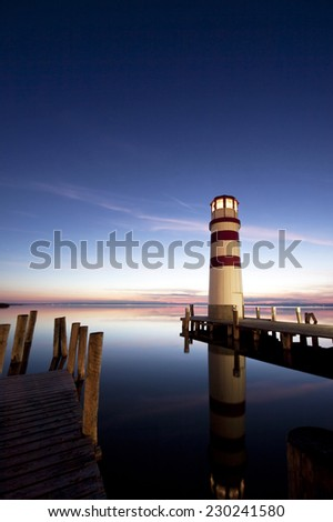 Beautiful lighthouse at night  - stock photo