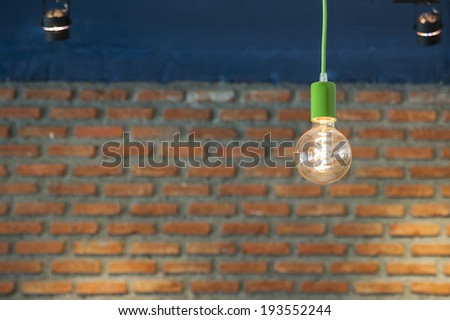 Beautiful lighting decor on brick wall - stock photo
