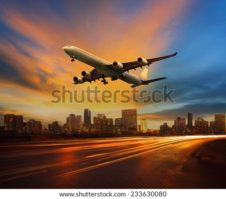 beautiful lighting of vehicle in land transportation and passenger jet plane flying above urban scene use for transport business and people traveling theme - stock photo