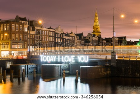 Beautiful lights on the bridge saying Today I Love You at the Damrak in Amsterdam