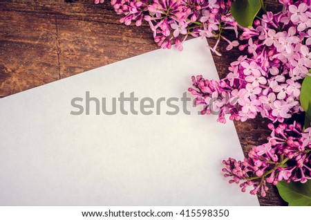 Beautiful lilac flowers on a wooden vintage board. Greeting card with place for text Happy Mother's Day. Retro style toned picture. Mother's day. Mothers Day gift. Mothers Day. - stock photo