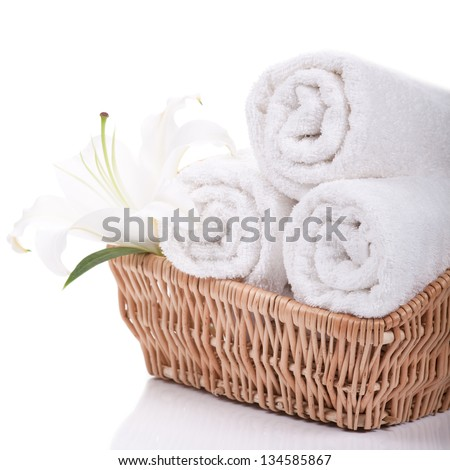 Beautiful lilly on towels rolls isolated on white