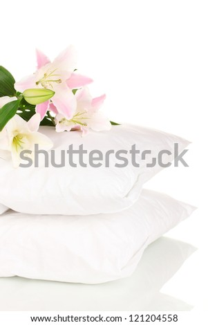 beautiful lily on pillows isolated on white