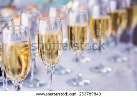 Beautiful line of different colored cocktails with smoke on a open air party, tequila, martini, vodka, and others on decorated catering bouquet table on open air party  - stock photo