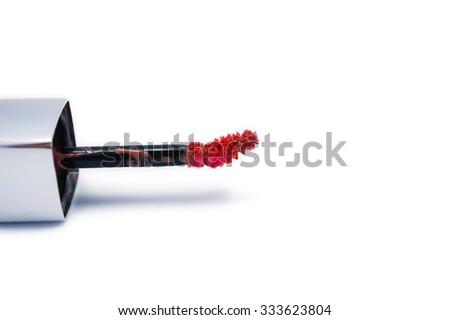 beautiful lip gloss brush, isolated on white - stock photo