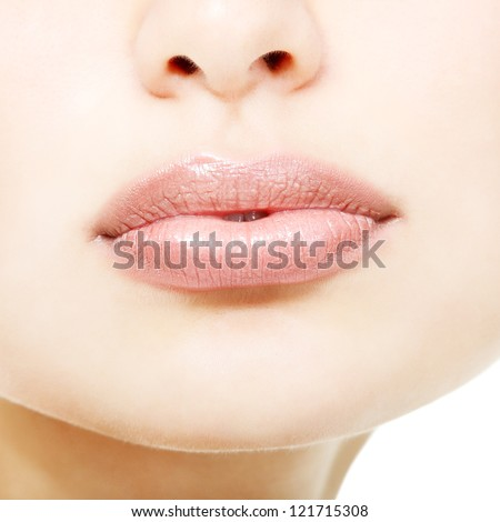 Beautiful lips of young fresh woman over white background - stock photo