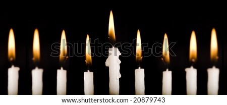 Beautiful lit hanukkah candles on black.  Super black background.  Carefully spotted and retouched. - stock photo