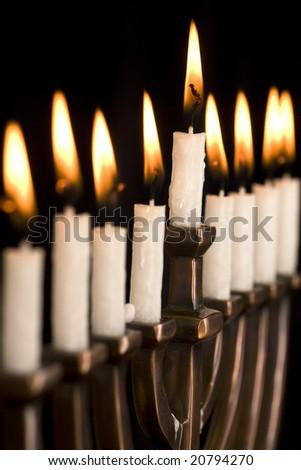 Beautiful lit hanukkah menorah on black.  Super black background.  Carefully spotted and retouched. - stock photo