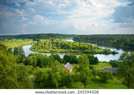 Beautiful Lithuanian summer landscape - View from Merkine fort hill to Nemunas river. Merkine is a town in Dzukija National Park in Lithuania, located at the confluence of the Merkys and Neman Rivers. - stock photo