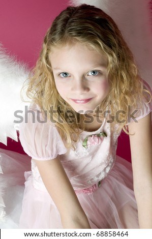Beautiful little angel girl with wings and pink dress