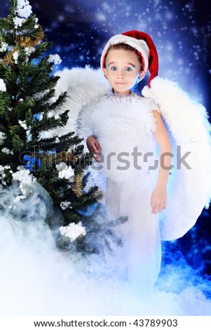 Beautiful little angelic child  at a christmas background.