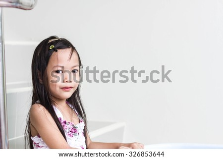 Beautiful little asian girl  playing on stair - stock photo