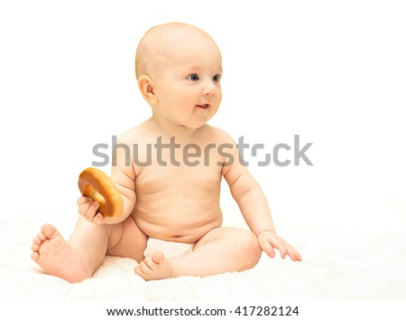 beautiful little baby boy sitting , isolated on a white background  - stock photo