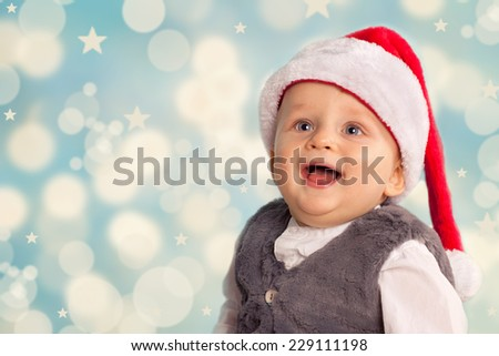 Beautiful little baby celebrates Christmas. New Year's holidays. Baby in a Christmas costume  - stock photo