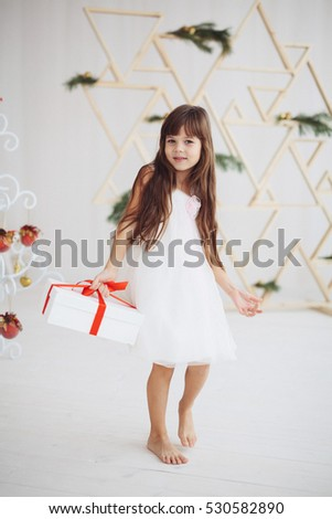 Beautiful little baby celebrates Christmas. New Year's holidays. Holiday and fun.