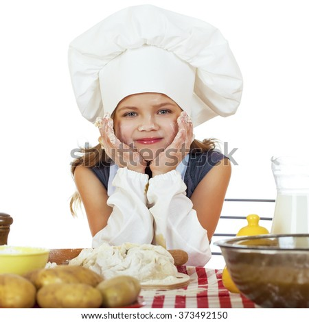 Beautiful little baby dressed as a cook, isolated on a white background - stock photo