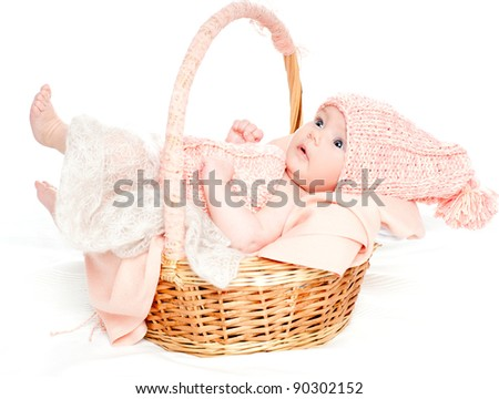 beautiful little baby girl in the basket