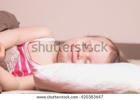 beautiful little baby girl sleeping and smiling (childhood, security, family)